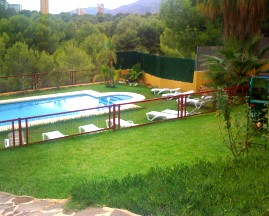 Garden and pool of the apartments. Holiday apartments, pool, Benidorm, Costa Blanca